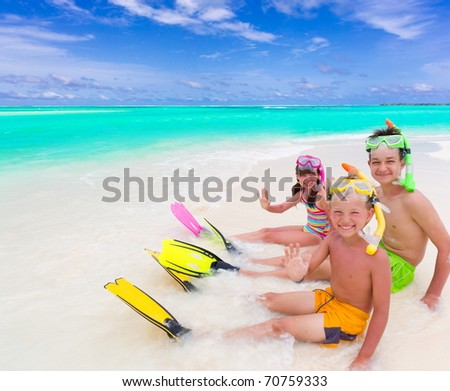 Kids on the beach - stock photo