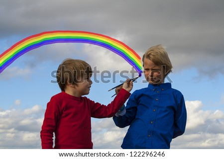 kids painting rainbow - stock photo