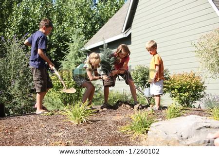 Kids planting a tree - stock photo