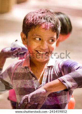 Kids play HOLI Indian color festival at Mumbai Maharashtra India Asia South East Asia - stock photo