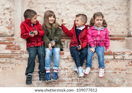 Kids playing against a wall. - stock photo