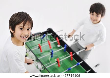 Kids playing board football - stock photo