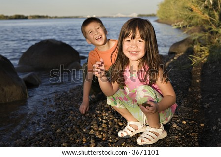 Kids Playing by the Columbia River in the Evening Sun - stock photo
