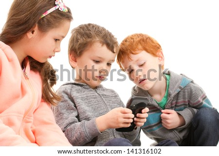 Kids playing games on mobile phone. Isolated on white.