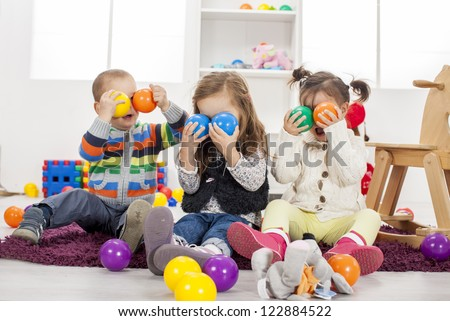 Kids playing in the room - stock photo