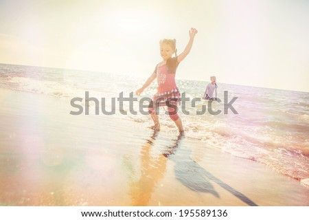 kids playing in the waves - stock photo