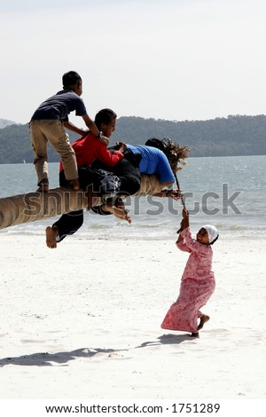 Kids playing on the beach in Asia. - stock photo