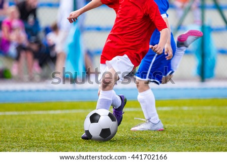 Kids Playing Soccer Football Match. Sport Soccer Tournament for Youth Teams. Soccer football background. - stock photo