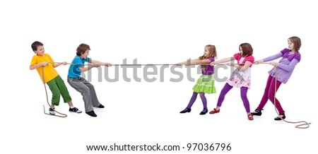 Kids playing tug of war - girls versus boys, isolated - stock photo