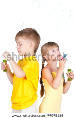 kids playing with bubbles isolated on white - stock photo