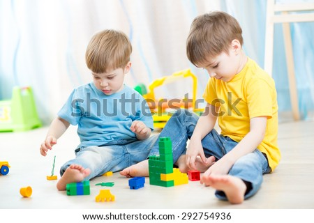 kids playing with constructor - stock photo
