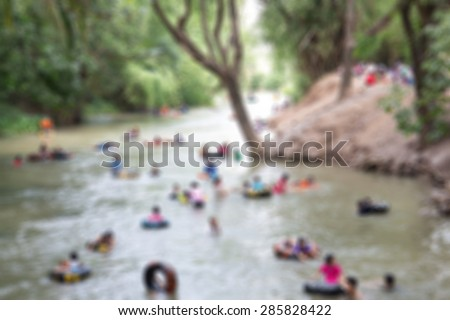 Kids playing with summer water levels in Thailand blur. - stock photo