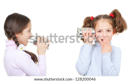 kids playing with tin can and string phone as communication concept - stock photo