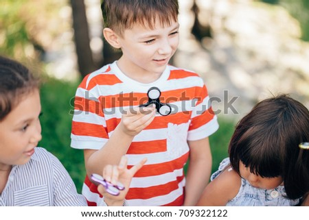 Kids posing with their fidget spinners outdoor