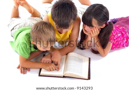 Kids reading book together - stock photo