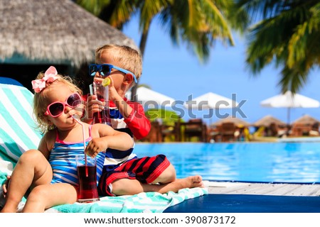 kids relax on tropical beach resort and drink juices - stock photo