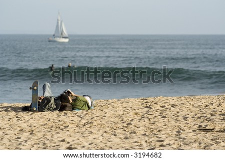 kids relaxing on the beach - stock photo