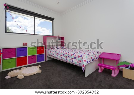 Kids room with toys and bed - stock photo