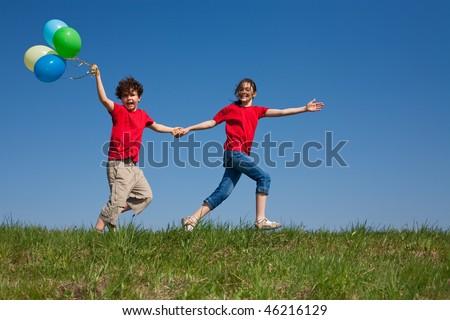Kids running against blue sky - stock photo