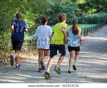 Kids running in park - stock photo