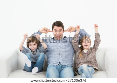 Kids screaming on the couch  - stock photo