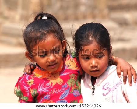 Kids sitting on the street of Kathmandu Nepal       - stock photo