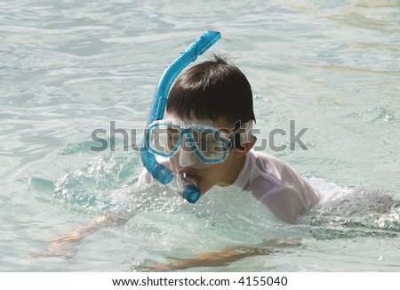 Kids snorkeling - stock photo