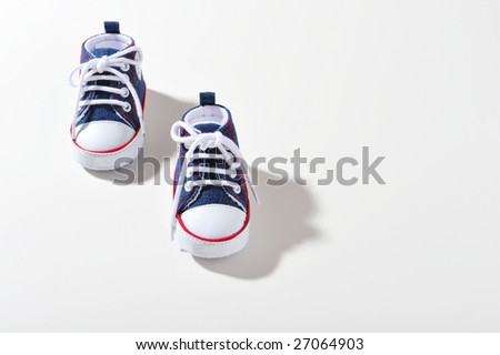 Kids sport shoes on white background, top view