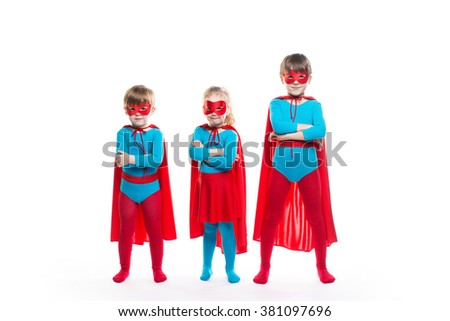 Kids superheroes. Boys and girl characters in costumes posing isolated on white background. - stock photo