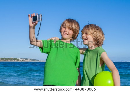 kids taking selfie on summer holiday in Mallorca Spain