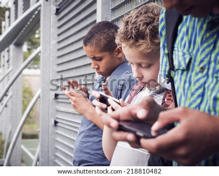 kids texting message on smartphone - stock photo