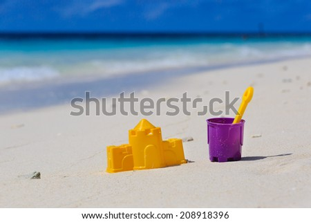 kids toys on tropical sand beach - stock photo