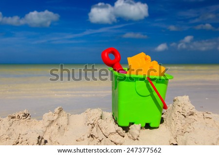 kids toys on white sand beach - stock photo