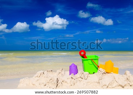kids toys on white sand tropical beach