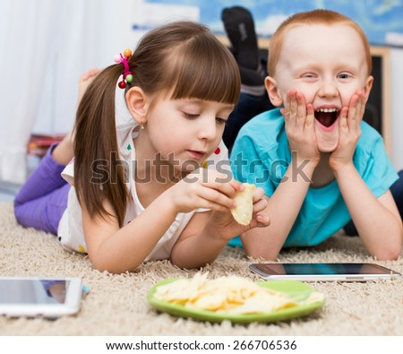 Kids using tablet computer - stock photo