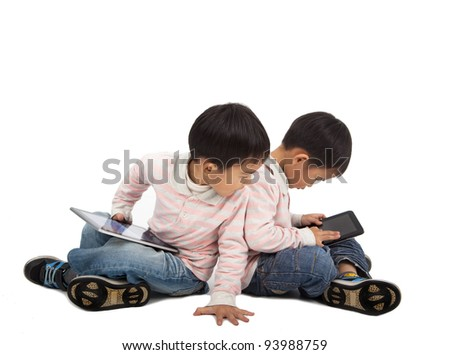 kids using tablet PC  and isolated on white - stock photo