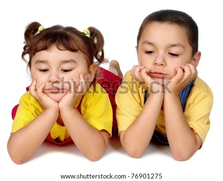 kids very bored looking down - stock photo