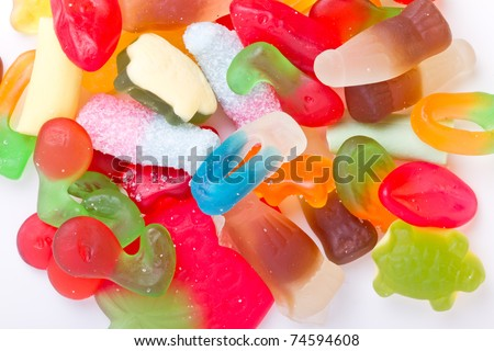 Kids vibrant multicoloured jelly sweet mix up background. - stock photo