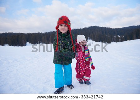 kids walking on snow at winter vacation in forest. happy children group have fun outdoor - stock photo