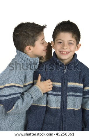 Kids whispering a secret - stock photo