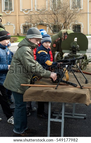 Kids with guns. Open day at the Suvorov military school. Saint Petersburg, Russia, April 2016