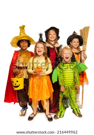 Kids with Halloween attributes in stage costumes - stock photo
