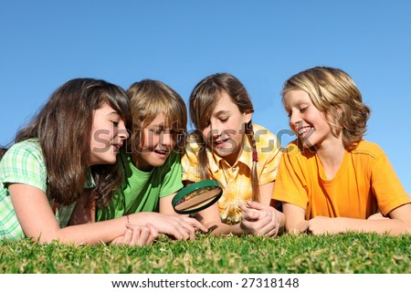 kids with magnifying glass - stock photo