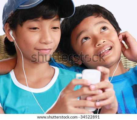 kids with music gadget - stock photo