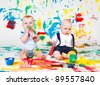 Kids with paint roller and paintbrushes - stock photo