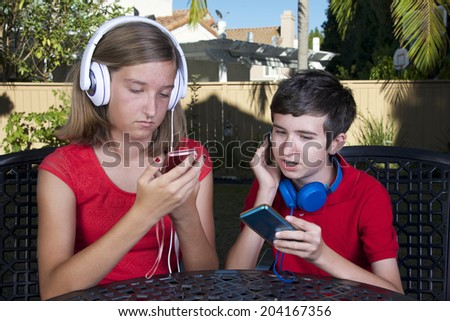 kids with technology phone game system music social media - stock photo