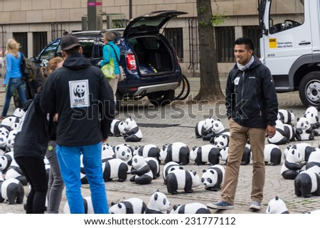 KIEL, GERMANY - AUGUST 14 2013: The WWF draws attention to the endangered giant panda with an action in the city of Kiel