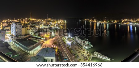 Kien Giang, Vietnam - April 8th, 2015: Panorama beauty of Ha Tien town at night with skyscrapers and lights marina along river to port makes city more beautiful and sparkling in Kien Giang, Vietnam