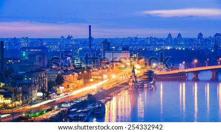Kiev city, Capital of Ukraine. View of the Dnieper river, River station, Havana bridges and Naberezhno-Kreschatitska street. Night panorama of Kyiv. - stock photo