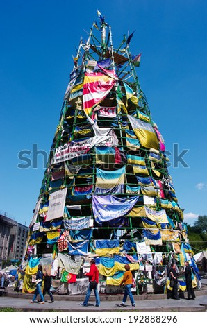 KIEV (KYIV), UKRAINE - MAY 11, 2014:  Christmas tree with national flags and placards on Maidan in Kiev, Ukraine. - stock photo